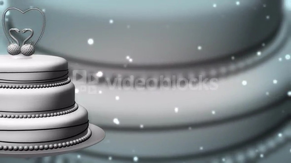 Rotating Cake with Lights in Background