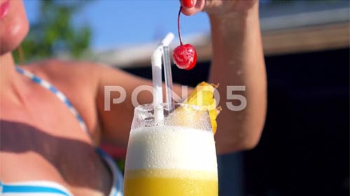 Woman Drinking Tropical Cocktail At Beach Resort