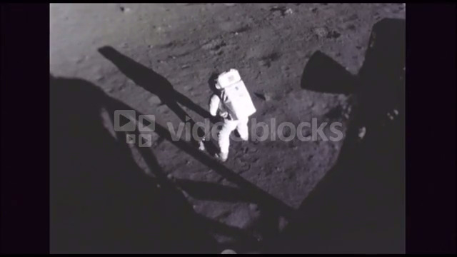 Astronaut Sampling Soil Contents of Moon Surface