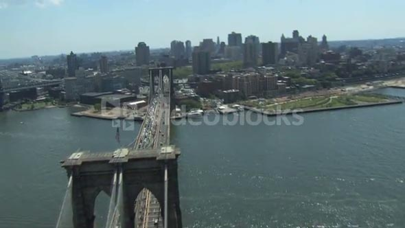 American flag on top of the Brooklyn Bridge