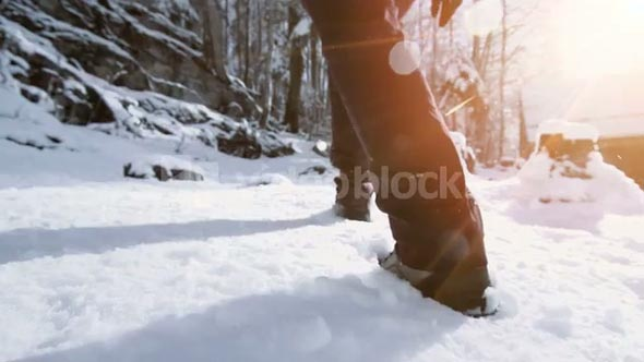 snow hiking walking. foot steps feet. slow motion.