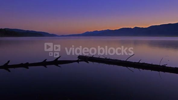 Time Lapse sunrise over peaceful water