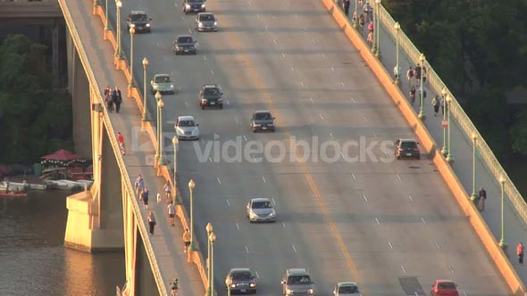 Cars Driving and People Walking Over Key Bridge