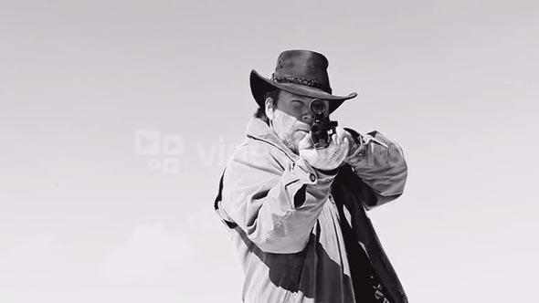 Rifleman Shoots Gun at Camera in Black and White