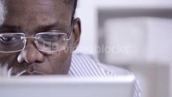 African American man using and viewing tablet computer
