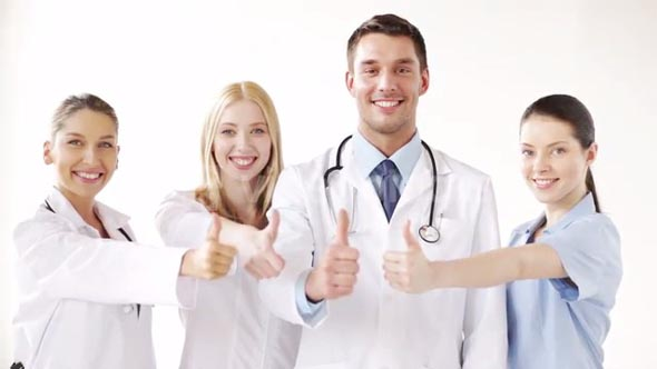 group of doctors with thumbs up