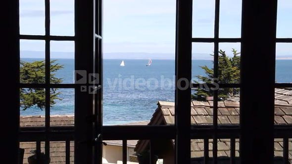 View Out Windows To Sailboats On Ocean