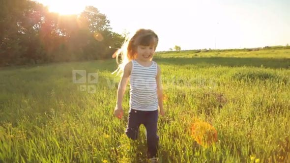 Girl running in field with smile