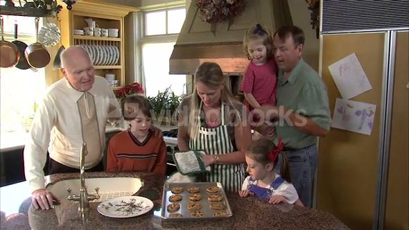 Mother Takes Cookies Out of Oven for Family