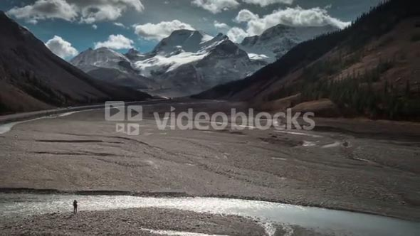 4K 60fps Aerial of Woman by Athabasca Rive in Jasper