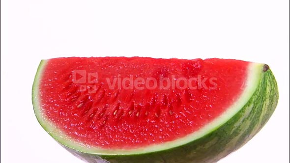 Quarter Watermelon Rotating on White Background