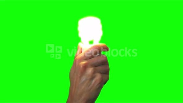 holding green energy lightbulb black green screen