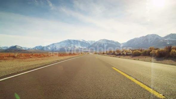 Road Through Desert Mountain Landscape