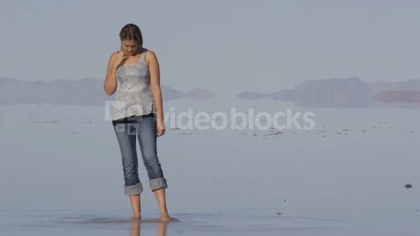 woman stands in lake
