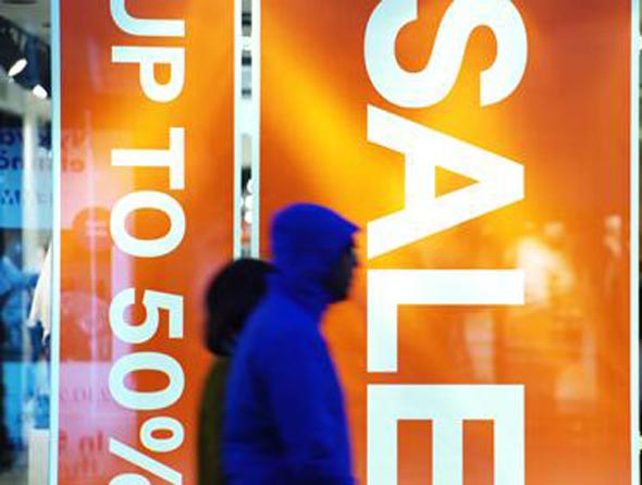 Sale sign at the showcase store. Holiday sales in the city center
