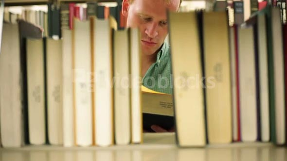 Reverse Angle Student Pulls Out Library Book