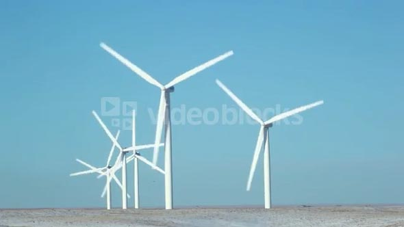 Row of Wind Turbines Spinning