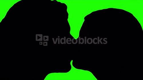 Man and woman kiss green screen