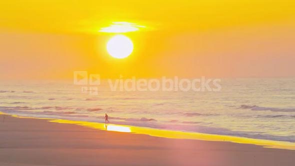 Serene Beach at Sunset with beach goer