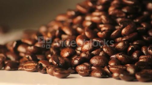 Rotating Pile of Coffee Beans Zoomed In