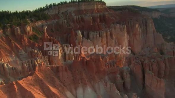 Aerial Shot Of Bryce Canyon National Park Tilt Up From Rugged Red Spires