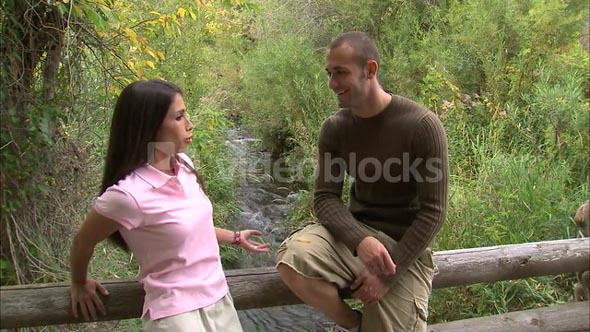 Couple Talking on a Bridge