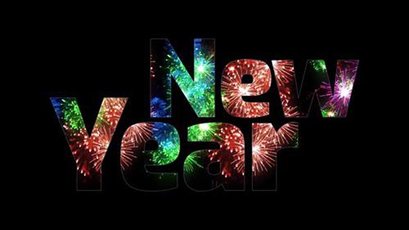 Beautiful multi colored fireworks glow through the text Happy New Year