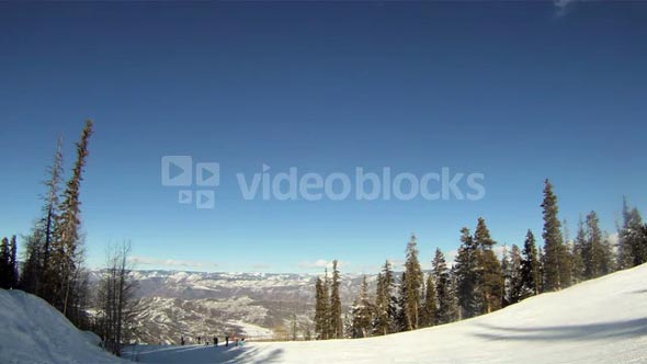 Skiers jump over camera on ski slopes