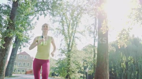 Runner woman running in park exercising outdoors