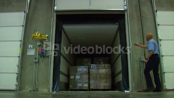 Man Opens Door To Reveal Cargo In Semitruck Trailer