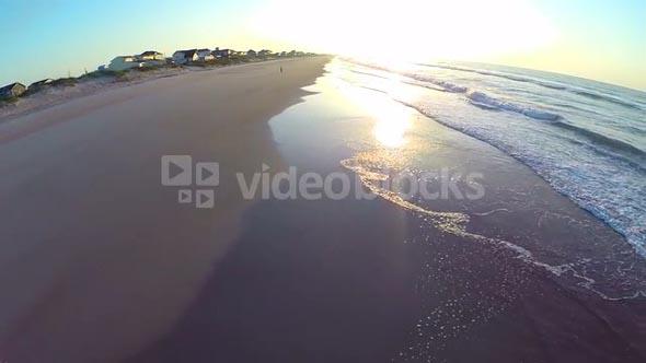 Aerial of Bright Sunrise on Beach
