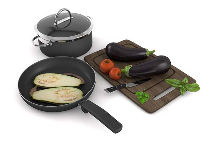 Kitchenware with pan pot tomato and zuccini
